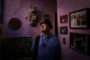Roberto Hernandez with some of his art in his San Francisco, Calif., home on Wednesday, March 19, 2014. Hernandez is the face of the old Mission. He's a 57-year-old vato who grew up playing with lowriders, and then realizing that he had to do something about the gangs and gunfire that were destroying his neighborhood. He became the Mission's best known community organizer — and still has his hand in nearly every event from gang intervention to the lowrider association and Carnaval celebrations. He recently turned his attention to the tech takeover — the Google buses and evictions of longtime tenants and stores.