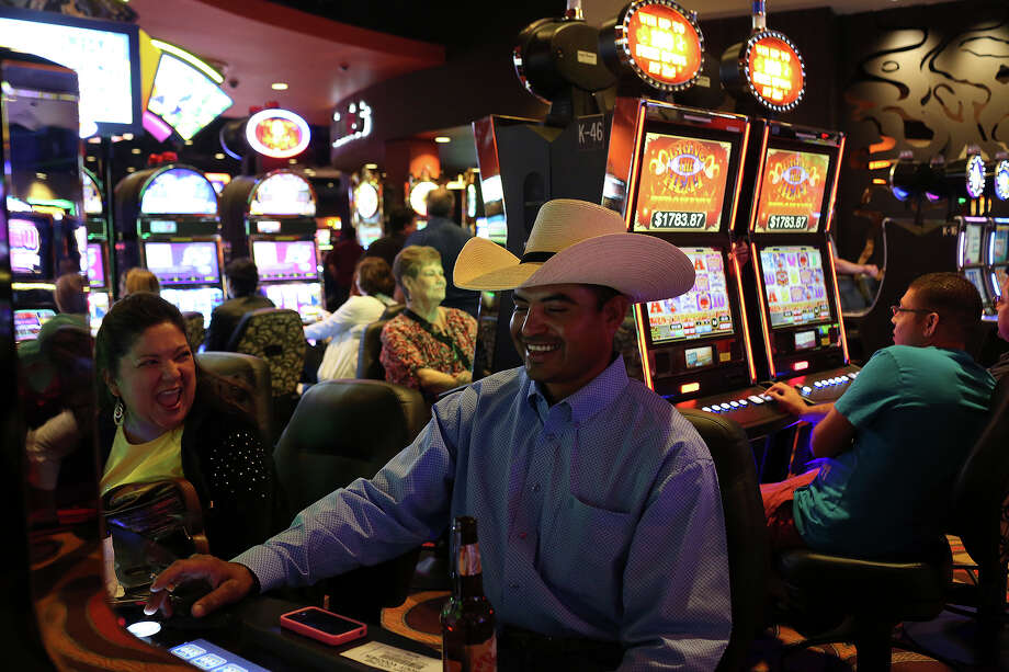 Jesus Tovar, of El Indio, plays Hot Shot Progressive with his wife, Sandra Tovar, left, at the Kickapoo Lucky Eagle Casino in Eagle Pass on Saturday, April 19, 2014. Jesus won $600 earlier in the night. Photo: Lisa Krantz, SAN ANTONIO EXPRESS-NEWS / SAN ANTONIO EXPRESS-NEWS
