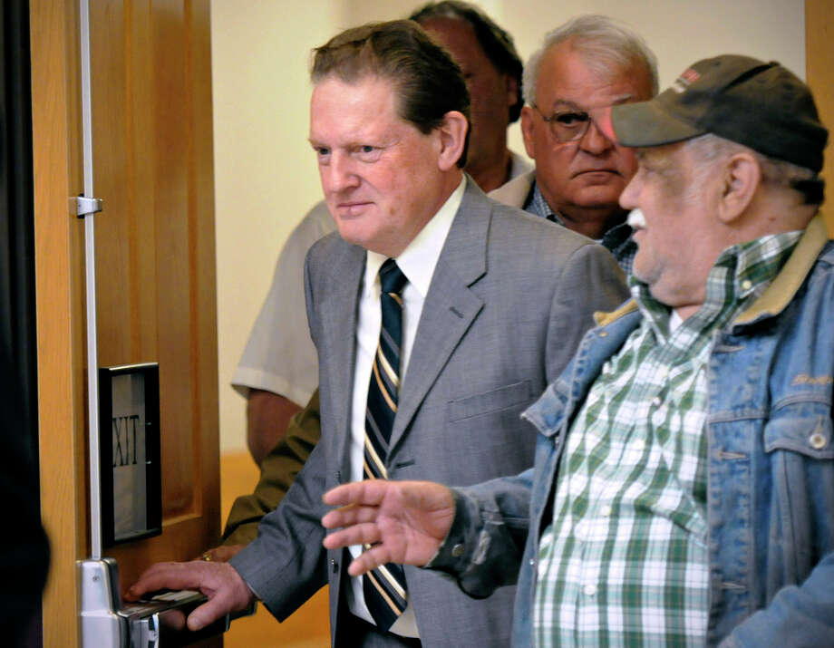 Byron Smith, center, comes out of a Morrison County courtroom in Little Falls, Minn., Monday, April 21, 2014, during a break in his trial. Smith shot and killed two teenagers who broke into his house on Thanksgiving Day 2012. Jurors began the process of deciding whether the killings were justified or whether the homeowner committed murder. Smith, 65, faces two counts of premeditated first-degree murder for the killings of Haile Kifer, 18, and Nick Brady, 17. . Photo: Jason Wachter, AP / ST. CLOUD TIMES