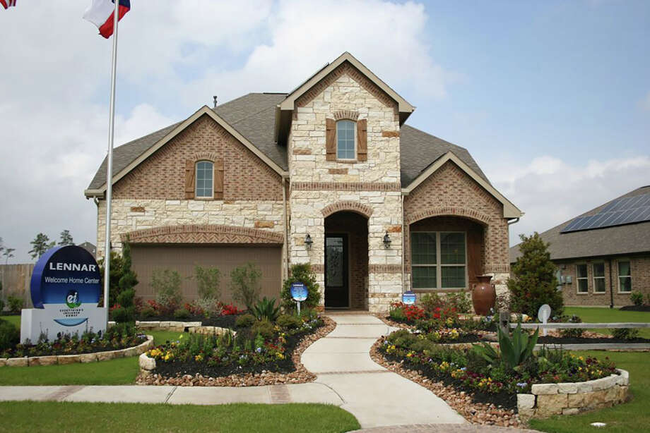 Shown is a Lennar design in Oakhurst at Kingwood, where builders' models will be open this weekend.