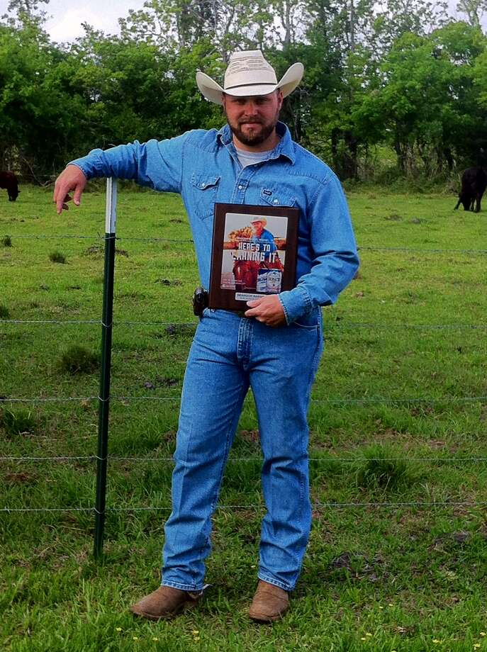 Rancher and EMT Brandon Harris with his new placard commemorating his placing as one of 8 Busch Heroes for 2014. Photo: Brandon Harris