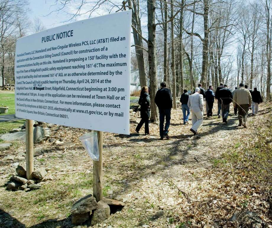 Members of the state Siting Council walk the area at the intersection of Aspen Ledges Road and Old Stagecoach Road in Ridgefield for a proposed cell tower. Thursday, April 24, 2014 Photo: Scott Mullin / The News-Times Freelance