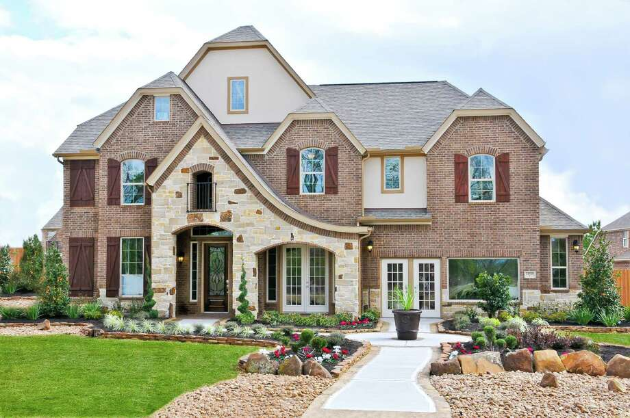 At Sam Houston Parkway northeast and W. Lake Houston Parkway, wooded Summerwood has eight homes ready for immediate move-in plus 20 more coming up for spring and summer. Shown is Ryland's Fortissimo model in the Summerwood Model Home Village. / 2011 FrenchBlue Photography
