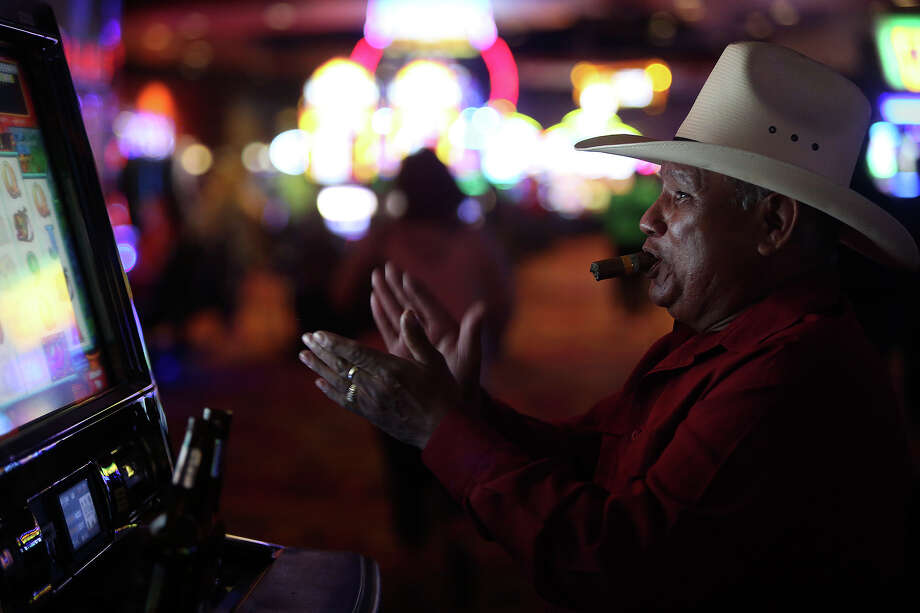 """Luis Barrientos, Jr., of San Antonio, plays Jumpin' Jalape–os at the Kickapoo Lucky Eagle Casino in Eagle Pass on Saturday, April 19, 2014. Barrientos said he won around $1200 playing the game for around 6 hours. """"I have confidence in this machine. I love this machine. I don't know why, but I do,"""" Barrientos says. """"Every time I play it, I win."""" Photo: Lisa Krantz, SAN ANTONIO EXPRESS-NEWS / SAN ANTONIO EXPRESS-NEWS"""