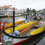 A moliceiros ride in 'Portuguese Venice' (Aveiro, Portugal)