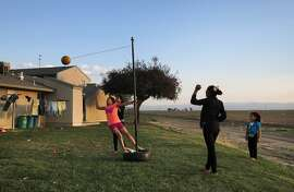 Monse Barragan (left), Melanie Ochoa and Maria Ochoa play tetherball as Natalie Trejo watches in Mendota (Fresno County).