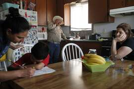 "Both unemployed, Jose Pineda Rivas, 61, center, stands in the kitchen with his wife, Maria Callejas, 43, right, as Ruth Fuentes, 32, left, helps her son Jose, 6, with his homework at Fuentes' home April 10, 2014 in Mendota, Calif. Rivas and his wife have been living with the Fuentes' family for four years. Rivas came to the United States in 1988 and was joined by his wife 3 years ago. They left five children behind in El Salvador, who they send money to every month. Both Rivas and his wife work in the fields for their income. Right now neither of them have been able to find steady work and the stress is taking its toll. Rivas has been having trouble sleeping and eating due to a constantly upset stomach and a toothache he cannot afford to repair. ""Our biggest worry is that tomorrow there is not going to be a job,"" said Rivas in Spanish through a translator. The historic drought combined with zero percent water allocation for farmers in the San Joaquin Valley means that many farmers are fallowing fields and many field workers are unemployed. In Mendota, a rural city of about 11,000 people about 35 miles west of Fresno, the jobless rate is 36 percent. Mayor Robert Silva is concerned that this summer it may reach as high as 50 percent. Though there are still precious few jobs this year in the fields, the streets of Mendota, which are usually empty in the middle of the day, are now haunted by people drifting up and down 7th Street, looking for work. Others families have already left to find work elsewhere. The schools have noticed a drop in attendance due to migration, 33 students have left with their families so far this year."