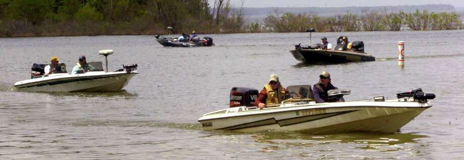 Fishermen head out for the last hour of competition at the Big Bass Splash Fishing Tournament at Lake Sam Rayburn in 2012.    Enterprise file photo / Beaumont