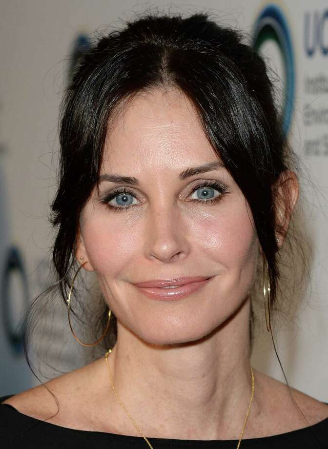 Courteney Cox. Birthday: June 15. Cox appears to have figured out how to suspend time, which is more evident in the next photo of her from 22 years ago. (Photo: Los Angeles, March 21, 2014).  Photo: Jason Merritt, Getty Images / 2014 Getty Images