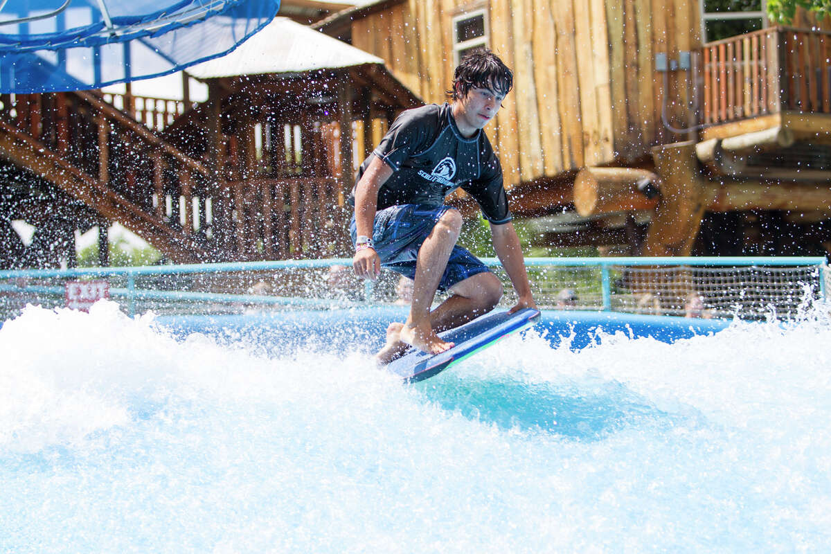 A visitor to Schlitterbahn rides the Boogie Bahn, a surfing ride that uses FlowRider wave simulator.