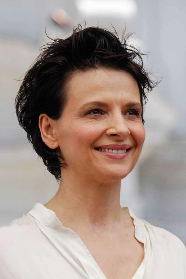 Juliette Binoche. Birthday: March 9. (Photo: Palacio de La Moneda, Chile, 2014).  Photo: Mario Tellez, Getty Images / Mario Tellez