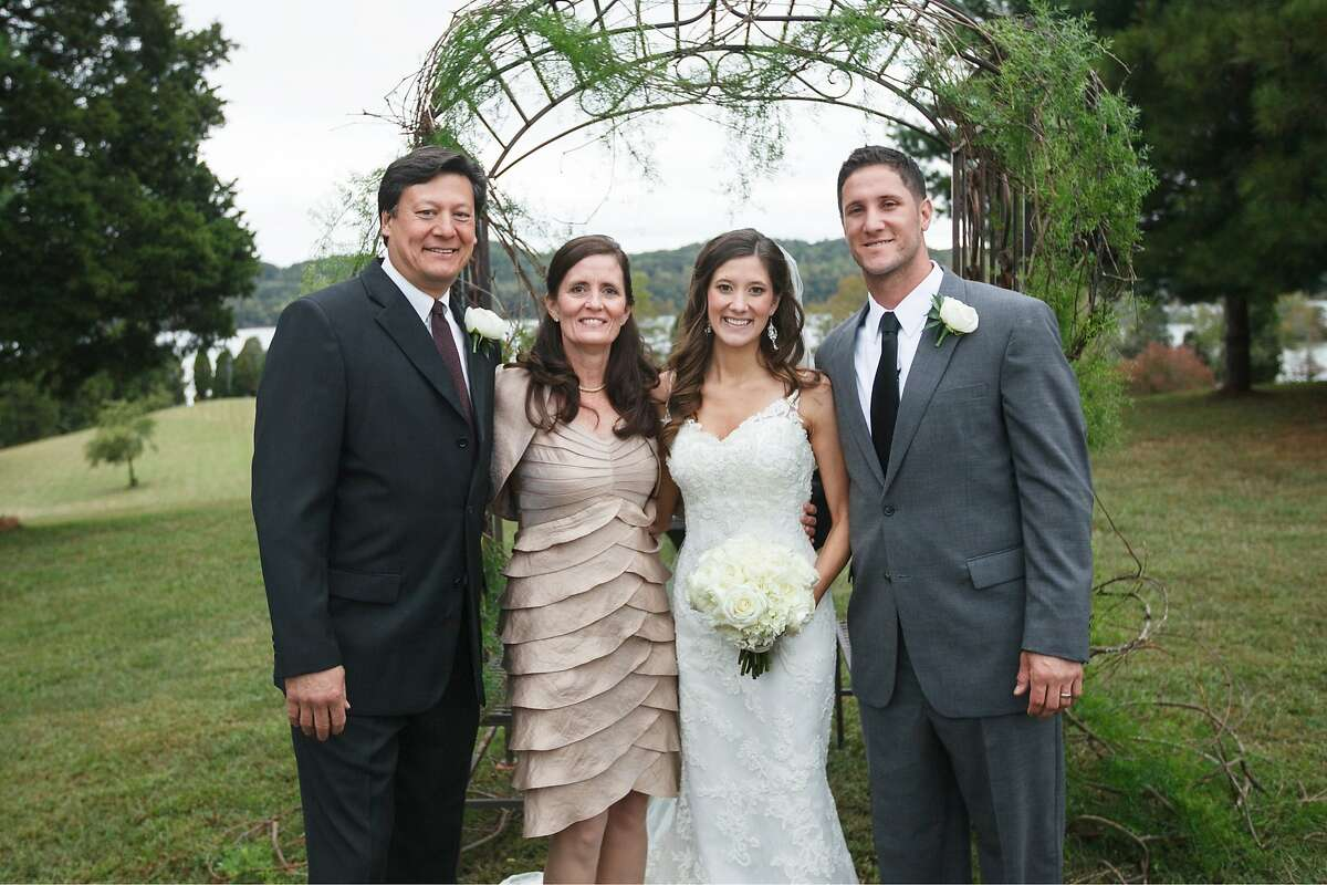 From left: Atlee Hammaker, a former All-Star pitcher with the Giants; his wife, Jenny; daughter, Jenna, and son-in-law Yan Gomes, a catcher with the Indians, pose the day of Jenna and Yan's wedding. Hammaker had once begged his daughter not to date ballplayers, but she met Gomes at the University of Tennessee.