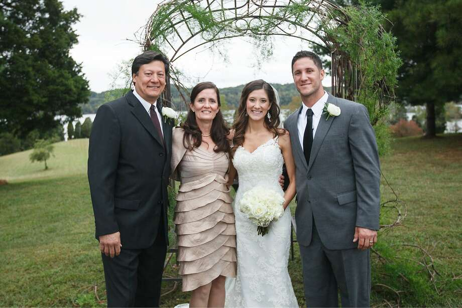 Atlee Hammaker (left), his wife, Jenny, daughter Jenna and Yan Gomes pose for a portrait at Jenna and Yan's 2012 wedding. Photo: Photo Courtesy Jenna Gomes