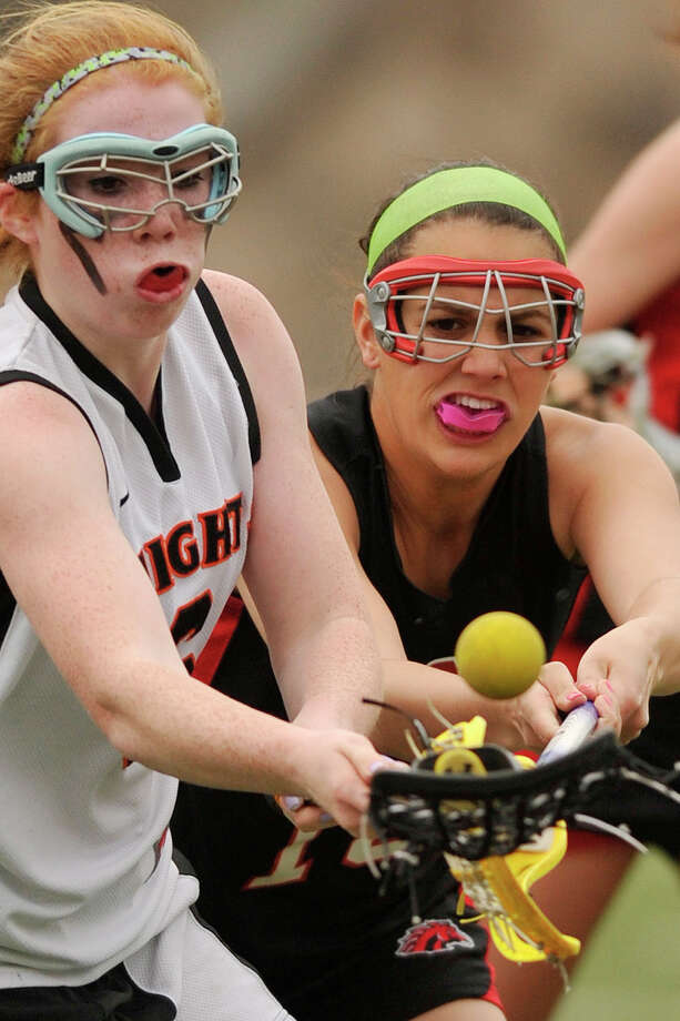 Stamford's Caroline Ryan and Fairfield Warde's Kelly Milicia compete for the loose ball during their game at Stamford High School in Stamford, Conn., on Tuesday, April 22, 2014. Fairfield Warde won, 12-6. Photo: Jason Rearick / Stamford Advocate