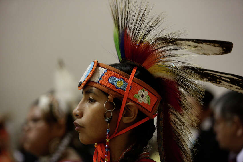 Sage Beene, 14, waits to dance during the Children's Pow Wow at the Alabama-Coushatta Tribe of Texas Reservation gymnasium on Saturday, January 25, 2014.