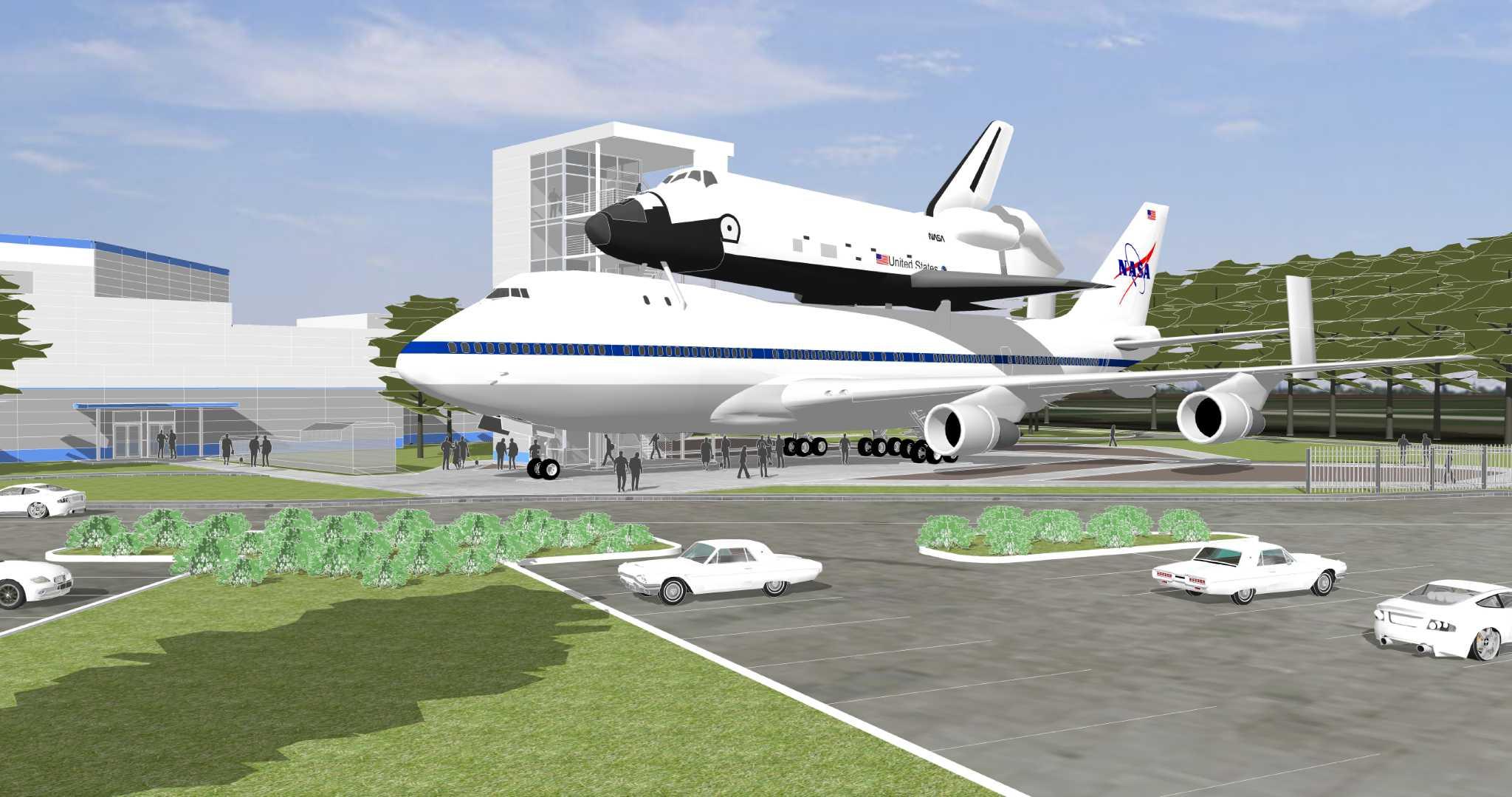 Space Center Houston hoisting shuttle replica onto top of ...