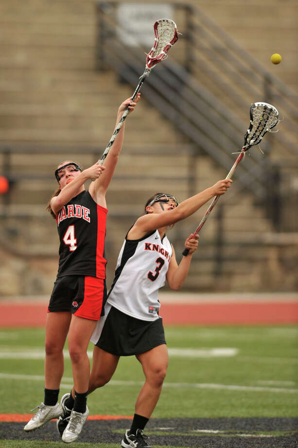 Fairfield Warde's Sarah Reilly and Stamford's Jasmine Li leap for the ball during their game at Stamford High School in Stamford, Conn., on Tuesday, April 22, 2014. Fairfield Warde won, 12-6. Photo: Jason Rearick / Stamford Advocate