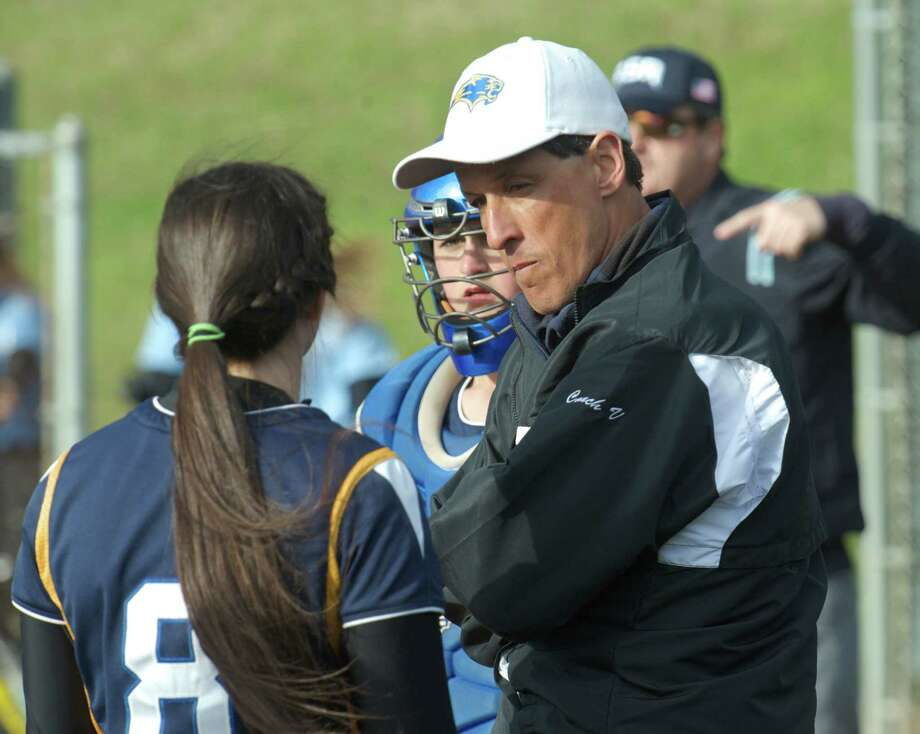 Brookfield softball coach Ron Ventura talks with his player Samantha O'Brien, #8, in-between innings, during the girls softball game between Oxford High School and Brookfield High School, in Brookfield, Conn, on Wednesday, April 23, 2014. Photo: H John Voorhees III / The News-Times Freelance