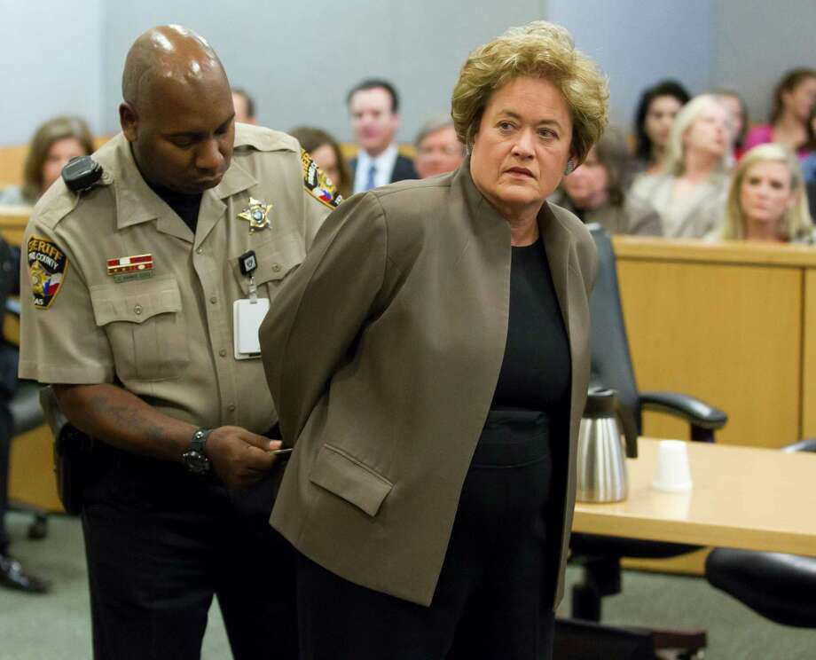 Travis County District Attorney Rosemary Lehmberg is handcuffed after pleading guilty to drunken driving on Friday, April 19, 2013, in court in Austin, Texas. Lehmberg was sentenced to 45 days in jail. Lehmberg, 63, was arrested last weekend and later issued a formal apology and said she would plead guilty to whatever charge the county prosecutor thought appropriate. (AP Photo/Austin American-Statesman, Ricardo B. Brazziell) AUSTIN CHRONICLE OUT, COMMUNITY IMPACT OUT, MAGS OUT; NO SALES; INTERNET AND TV MUST CREDIT PHOTOGRAPHER AND STATESMAN.COM Photo: RICARDO B. BRAZZIELL, Associated Press / AUSTIN AMERICAN-STATESMAN