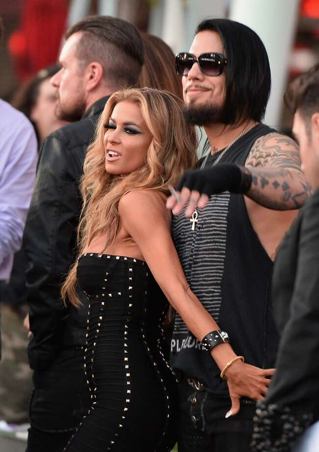 Model Carmen Electra (L) and guitarist Dave Navarro attends the 6th Annual Revolver Golden Gods Award Show at Club Nokia on April 23, 2014 in Los Angeles, California. Photo: Kevin Winter, Getty Images