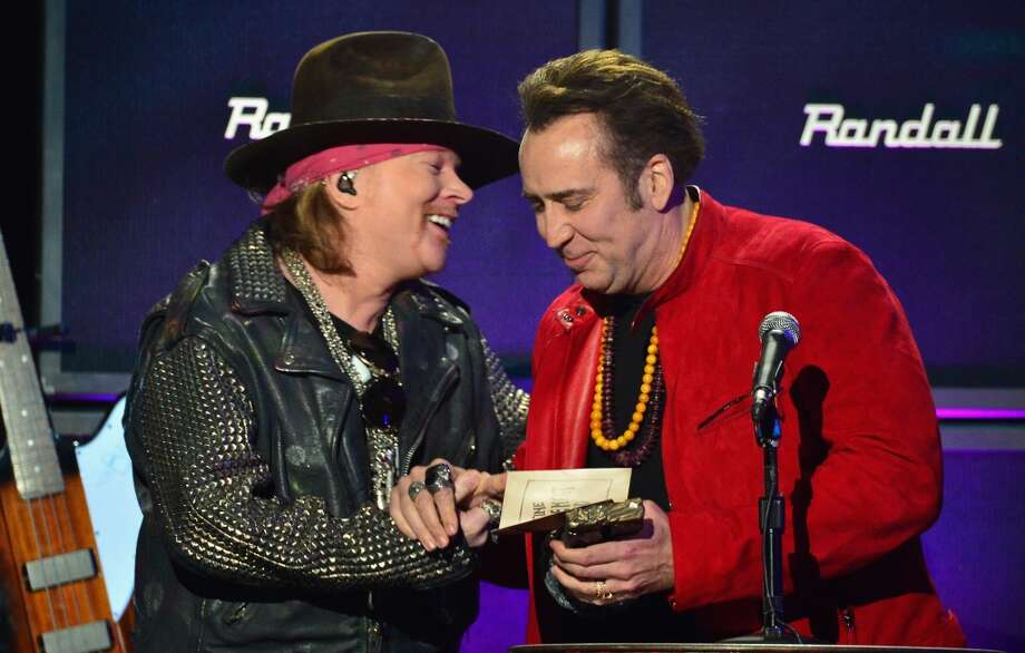 Singer Axl Rose (L) and actor Nicolas Cage speak onstage at the 2014 Revolver Golden Gods Awards at Club Nokia on April 23, 2014 in Los Angeles, California. Photo: Frazer Harrison, Getty Images