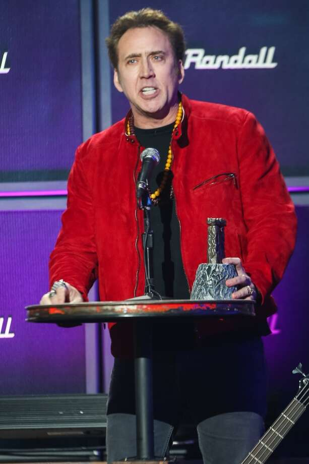 Actor Nicolas Cage speaks on stage at the 6th Annual Revolver Golden Gods Award Show at Club Nokia on April 23, 2014 in Los Angeles, California. Photo: Paul A. Hebert, Associated Press