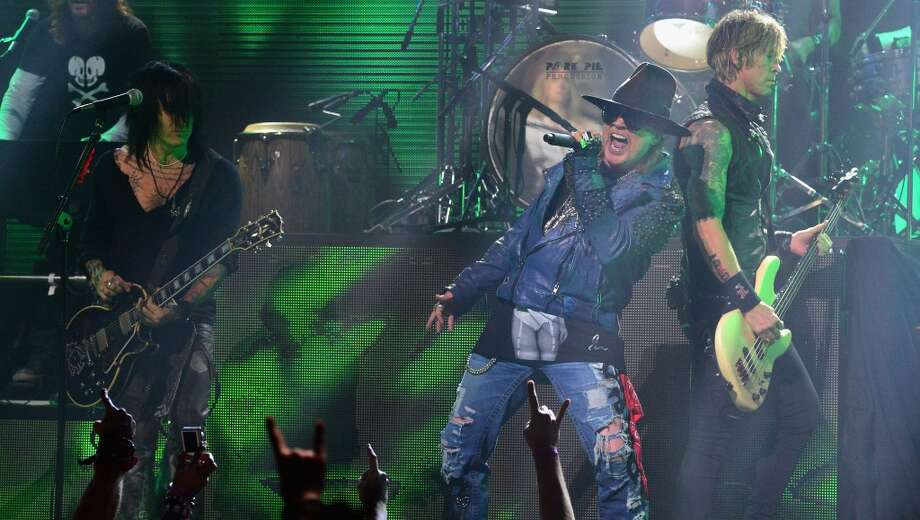 (L-R) Guitarist Richard Fortus, singer Axl Rose and bassist Duff McKagan perform onstage at the 2014 Revolver Golden Gods Awards at Club Nokia on April 23, 2014 in Los Angeles, California. Photo: Frazer Harrison, Getty Images