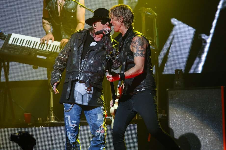 Axl Rose, left, and Duff McKagan of Guns N' Roses perform at the 6th Annual Revolver Golden Gods Award Show at Club Nokia on April 23, 2014 in Los Angeles, California. Photo: Paul A. Hebert, Associated Press