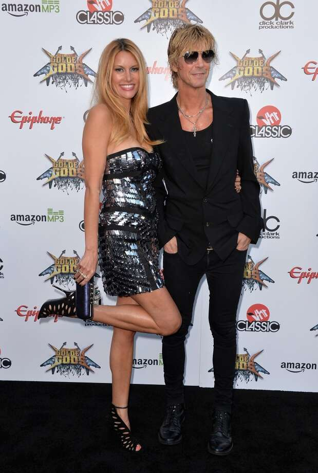 Model Susan Holmes (L) and Duff McKagan attend the 6th Annual Revolver Golden Gods Award Show at Club Nokia on April 23, 2014 in Los Angeles, California. Photo: Frazer Harrison, Getty Images