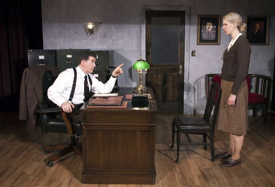 """The Director (Michael Ray Wisely) admonishes employee Anna (Beth Wilmurt) in """"The Letters."""" Photo: Sarah Roland"""