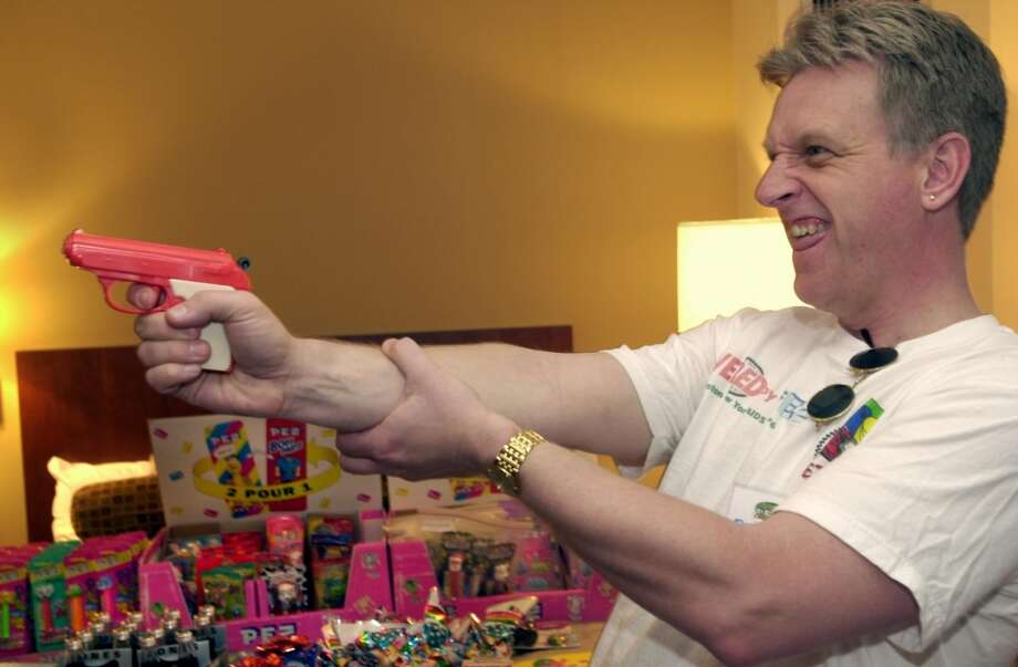 Stamford_042701_Peter Fuhrmeister of Waterford, Conn., shoots a Pez candy across a friend's hotel room with the Pez gun he had just purchased at the Northeast Pez Collectors' Gathering. Pezheads from across the United States, Japan and Europe congregate at the Sheraton to revel in their love of Pez collectibles. Andrew Sullivan.Staff photo Photo: ST