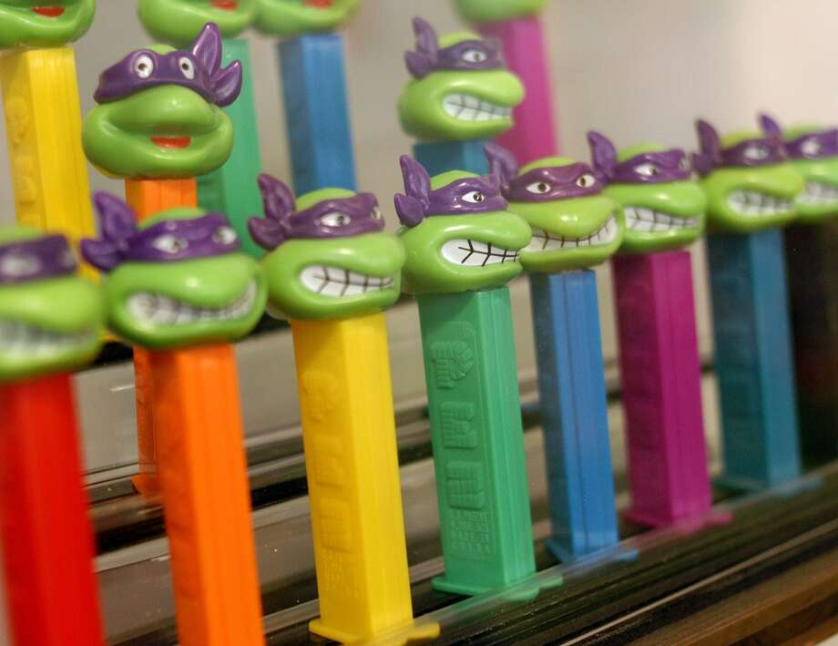 EASTON, PA - AUGUST 12: Teenage Mutant Ninja Turtle PEZ dispensers are grouped together at the Easton Museum of PEZ Dispensers August 12, 2003 in Easton, Pennsylvania. The museum is set up to show how the PEZ dispenser designs reflect the time period in which they were made. The collection consists of about 1,500 PEZ dispensers from 1950 to present. (Photo by William Thomas Cain/Getty Images) Photo: Getty Images