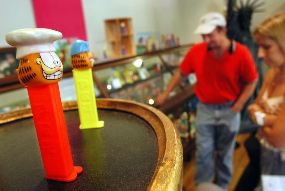 EASTON, PA - AUGUST 12: A Garfield PEZ dispenser is on display as tourists view the collection at the Easton Museum of PEZ Dispensers August 12, 2003 in Easton, Pennsylvania. The museum is set up to show how the PEZ dispenser designs reflect the time period in which they were made. The collection consists of about 1,500 PEZ dispensers from 1950 to present. (Photo by William Thomas Cain/Getty Images) Photo: Getty Images
