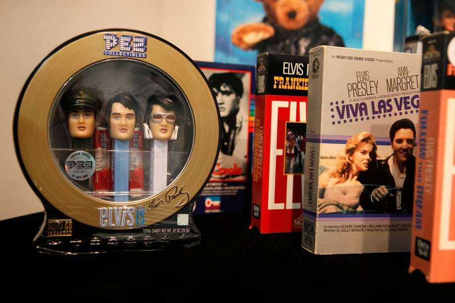 CHICAGO - OCTOBER 15:  Elvis Presley Pez candy dispensers are displayed with other Elvis memorabilia at the Leslie Hindman auction house October 15, 2009 in Chicago, Illinois. The items, which include a clump of Elvis' hair, will be auctioned October 18. The items are from the collection of Gary Pepper a long-time Elvis friend and president of one of his first fan clubs.  (Photo by Scott Olson/Getty Images) Photo: Getty Images