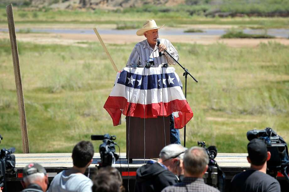 BUNKERVILLE, NV - APRIL 24:  Rancher Cliven Bundy speaks during a news conference along the Virgin River near his ranch on April 24, 2014 in Bunkerville, Nevada. The Bureau of Land Management and Bundy have been locked in a dispute for a couple of decades over grazing rights on public lands.  (Photo by David Becker/Getty Images) Photo: David Becker, Getty Images