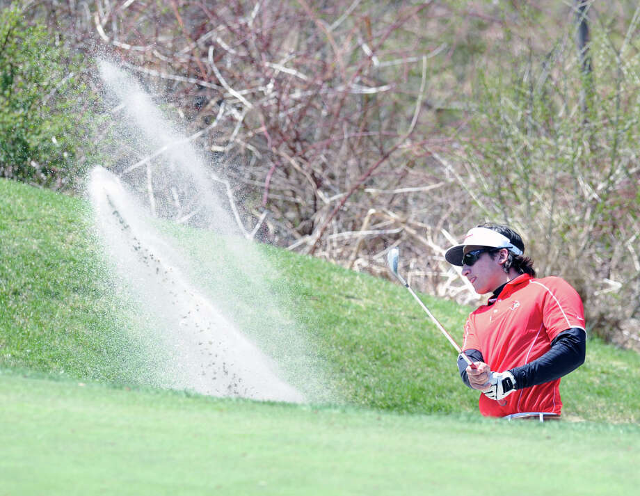 Paul Pastore of Greenwich High School shoots out of a sand trap during the Brunswick School Invitational Golf Tournament at the Round Hill Club, Greenwich, Conn., Thursday, April 24, 2014. Photo: Bob Luckey / Greenwich Time