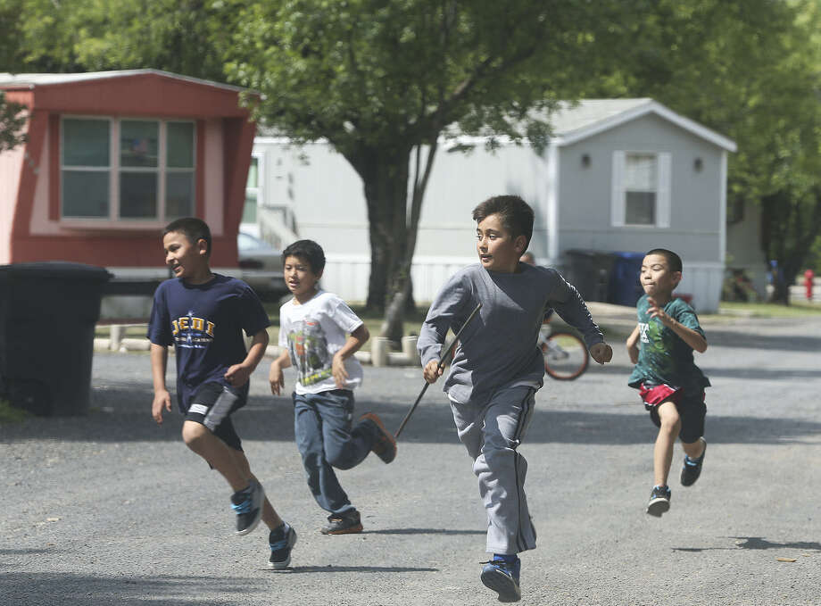 Boys play in the Mission Trails Mobile Home Community. Ignoring how rezoning would affect this and other tightknit communities is no way to implement public policy. Photo: Tom Reel / San Antonio Express-News