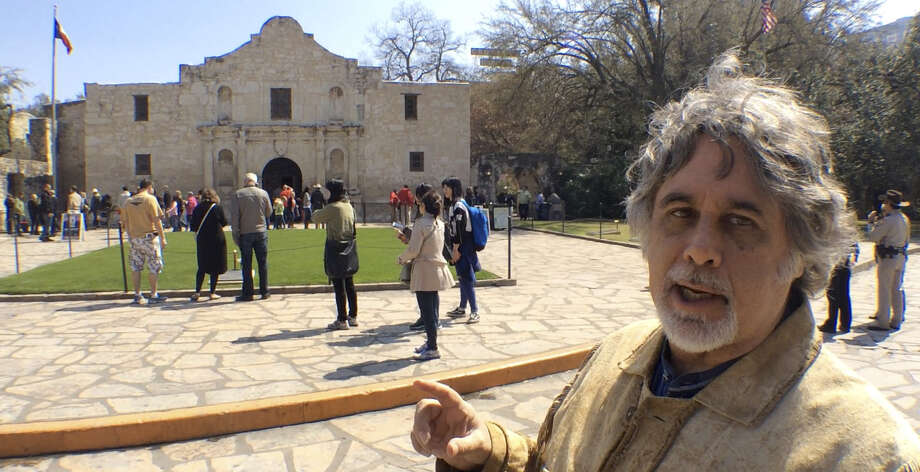 Gary Foreman, documentarian and Alamo fan,  conducts a tour of the Alamo March 6. See the tour online at www.expressnews.com. Photo: Josh Brodesky / San Antonio Express-News
