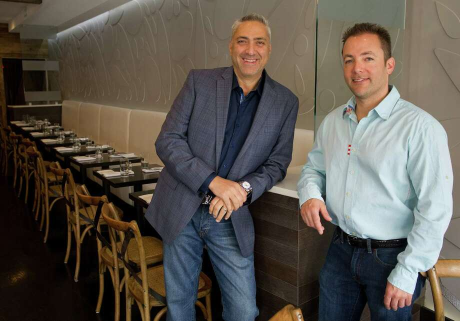 Co-owners Gino Riccio, left, and Judd Malin, right, pose for a photo at their restaurant, F.I.S.H Restaurant + Bar on Bedford Street in Stamford, Conn., on Wednesday, April 23, 2014. Photo: Lindsay Perry / Stamford Advocate