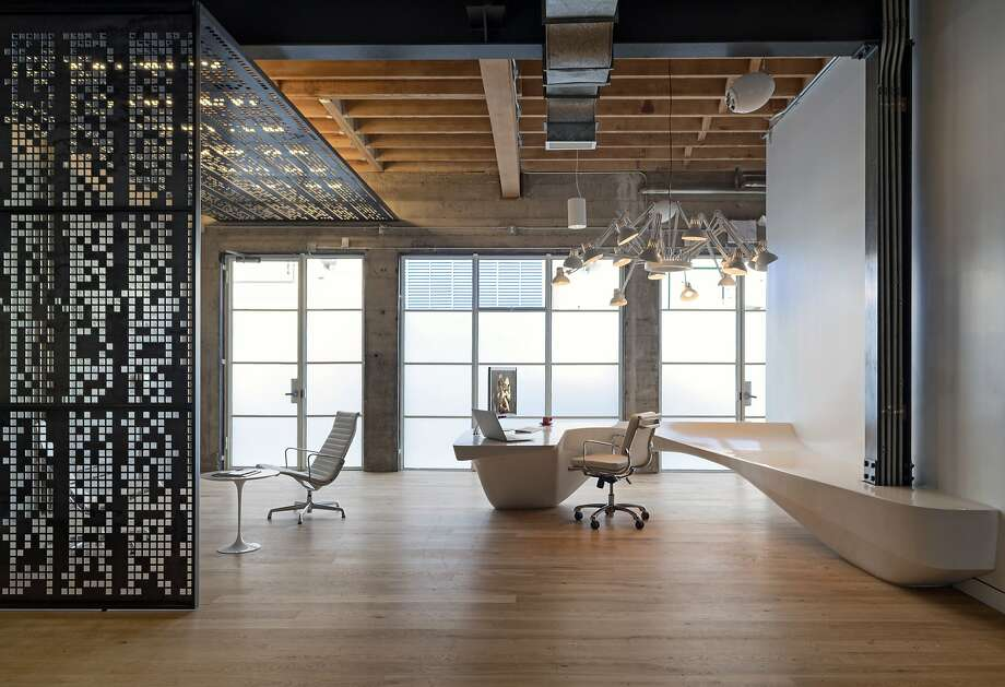 Giant Pixel's offices offer a mashup of industrial and sleek where a curved reception desk welcomes clients. Photo: Jasper Sanidad