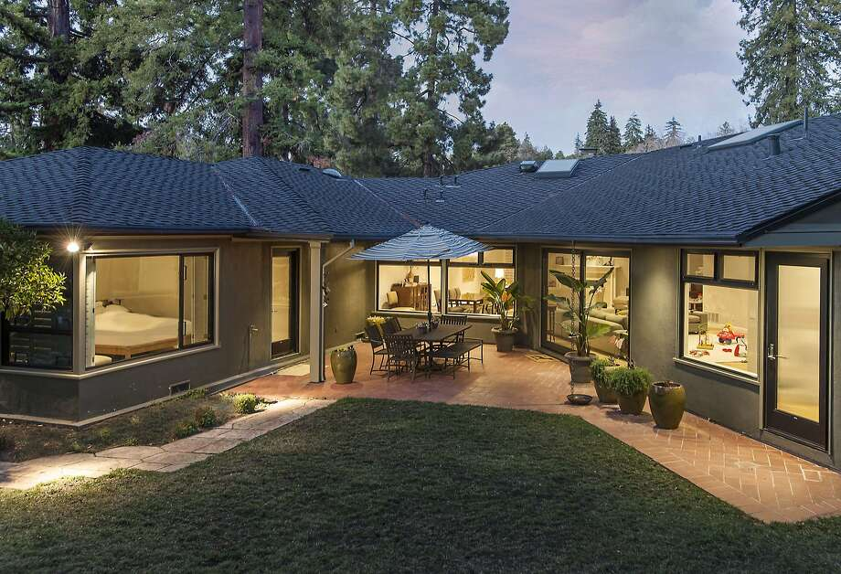 The backyard of the home includes a level lawn and patio. Photo: Scott Fitzgerrell
