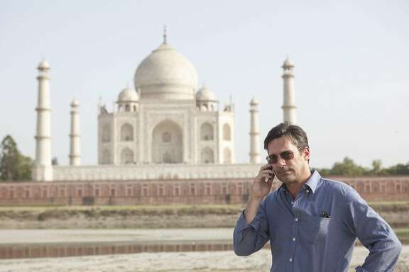 """Real-life sports agent J.B. Bernstein (Jon Hamm) goes to India to find athletes who had never picked up a baseball and turn them into major-league prospects in """"Million Dollar Arm."""" Photo credit: Walt Disney Studios.   DF-05187R..Jon Hamm stars as sports agent JB Bernstein in Walt Disney PicturesÕ ÒMillion Dollar Arm.Ó..Ph: Ishika Mohan..©Disney Enterprises, Inc. All Rights Reserved."""