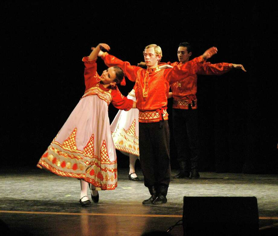 Members of the St. Petersburg, Russian youth dance group Rossijanochka show some traditional moves in a previous performance. The group is back in the United States and will be performing in Norwalk and Ridgefield, Conn., May 3, and May 4, 2014, respectively. Photo: Contributed Photo / Stamford Advocate Contributed