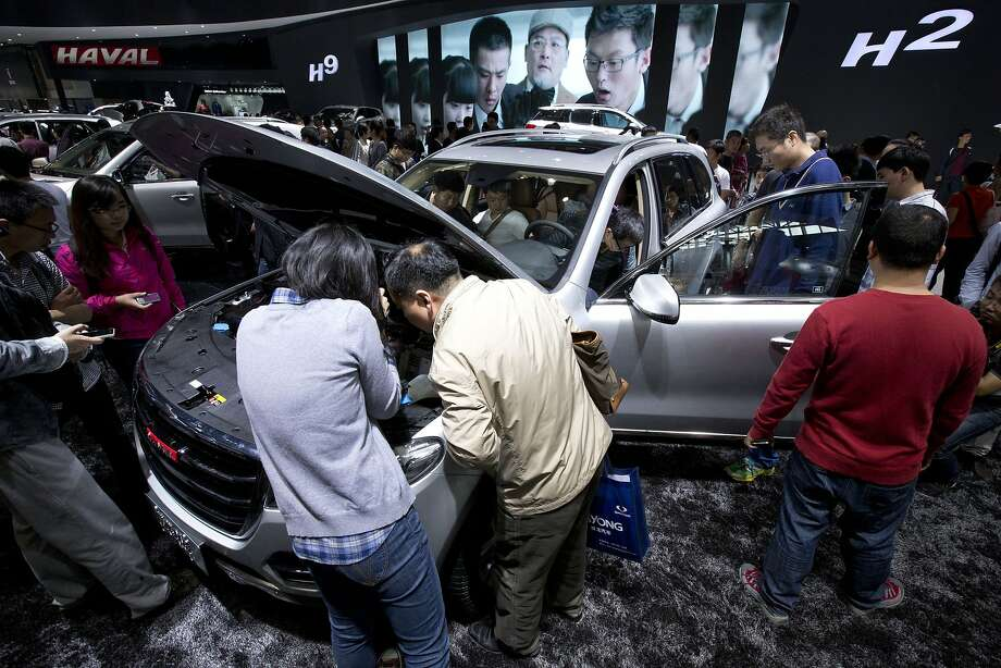 Visitors check a Chinese home-made Haval H8 at the China Auto show in Beijing, Wednesday, April 23, 2014.  Photo: Alexander F. Yuan, Associated Press