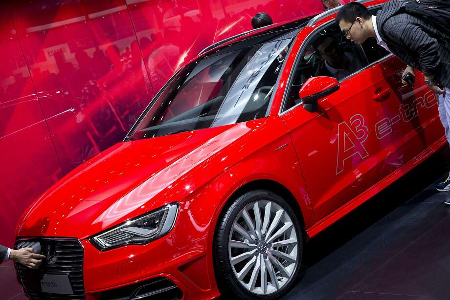 Visitors check an Audi A3 e-tron electric car at the China Auto show in Beijing, Wednesday, April 23, 2014.  Photo: Alexander F. Yuan, Associated Press
