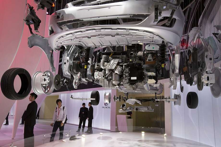 A visitor looks at the interior of a vehicle displayed at the China Auto show held in Beijing, China, Sunday, April 20, 2014.  Photo: Ng Han Guan, Associated Press