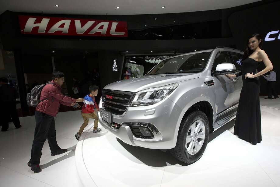A model poses near Chinese SUV maker Great Wall Motors' Haval 9 displayed at the China Auto show held in Beijing, China, Sunday, April 20, 2014.  Photo: Ng Han Guan, Associated Press