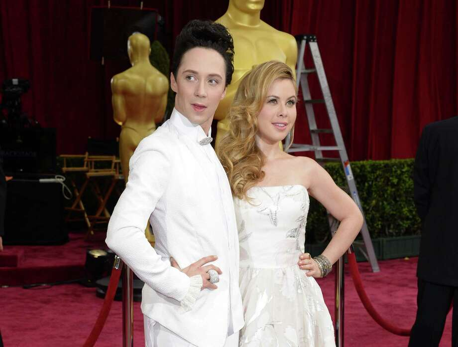 Johnny Weir and Tara Lipinski attend the Oscars in Los Angeles. NBC has added them as fashion correspondents on its Kentucky Derby coverage in recognition of the Derby's heavily female audience. Photo: Associated Press / Invision
