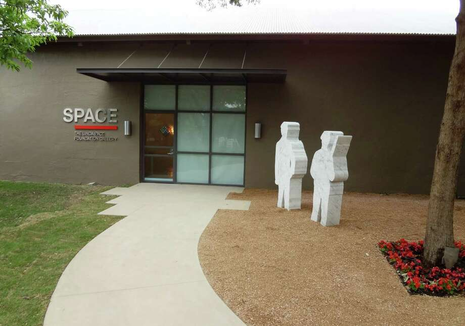 Daniel J. Martinez's marble sculptures stand guard outside the Linda Pace Foundation's new SPACE gallery. Photo: Steve Bennett / San Antonio Express-News