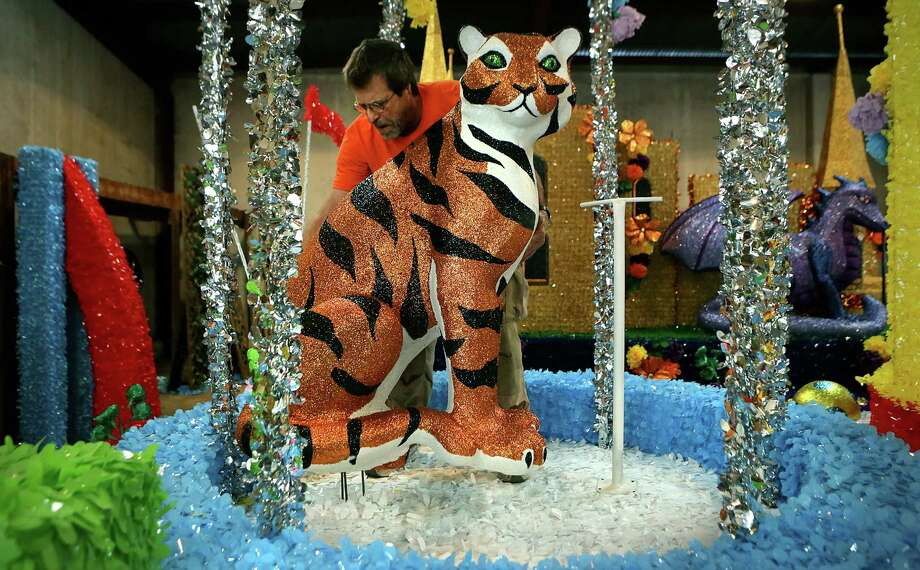 Clyde Watts, owner of Lone Star Parade Floats Co, positions a tiger on a float that will be used in the upcoming Fiesta Parades.  Monday, April 21, 2014. Photo: BOB OWEN, San Antonio Express-News / © 2012 San Antonio Express-News
